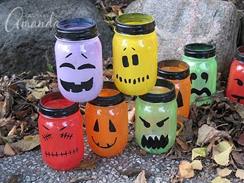 Full tutorial on how to make these AWESOME Halloween luminaries! I LOVE all the colors and faces! From Amanda Formaro at Crafts by Amanda