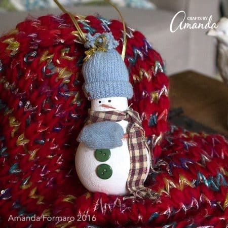 Turn an old burnt out light bulb into an adorable light bulb snowman ornament to hang on your tree year after year after year! Great homemade gift idea!