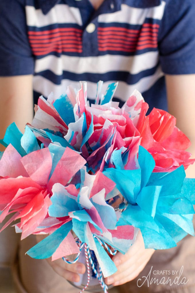 boy holding bouquet of coffee filter flowers
