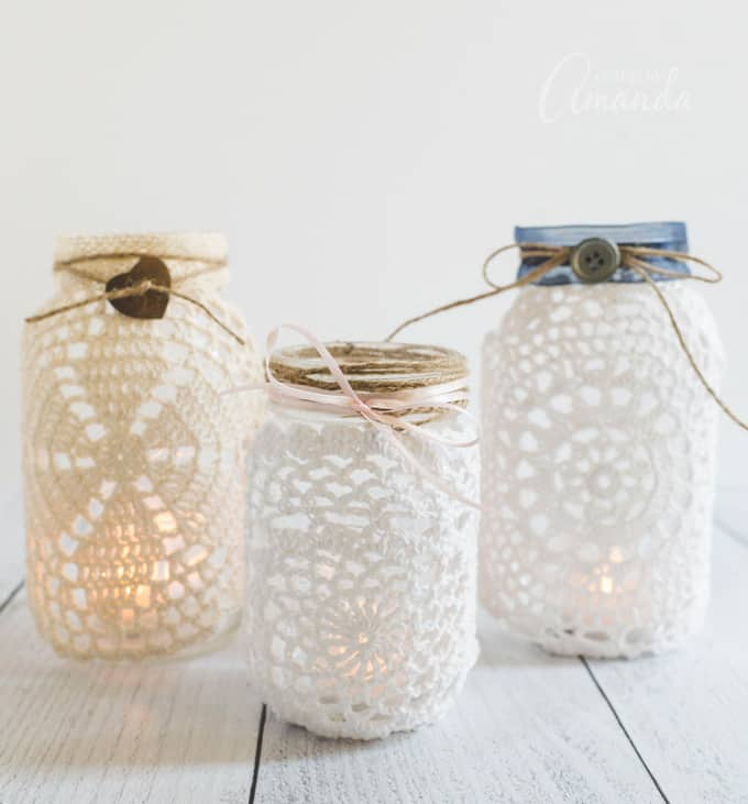 3 mason jar luminaries with doilies