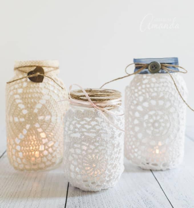 3 mason jar luminaries with doilies