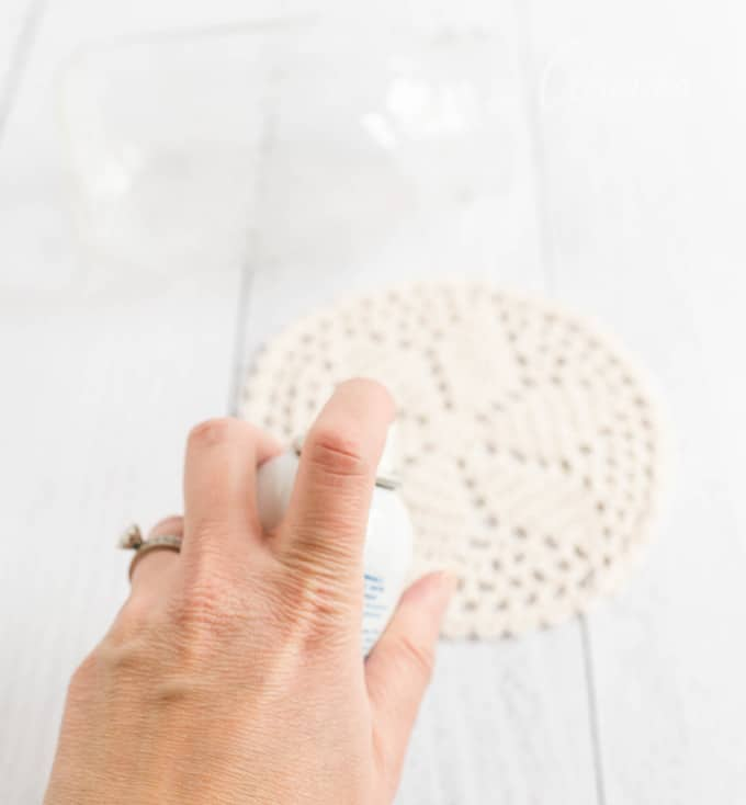 spray doily with adhesive spray