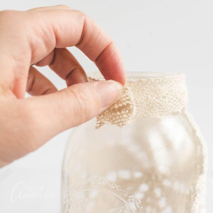 tying ribbon around jar rim