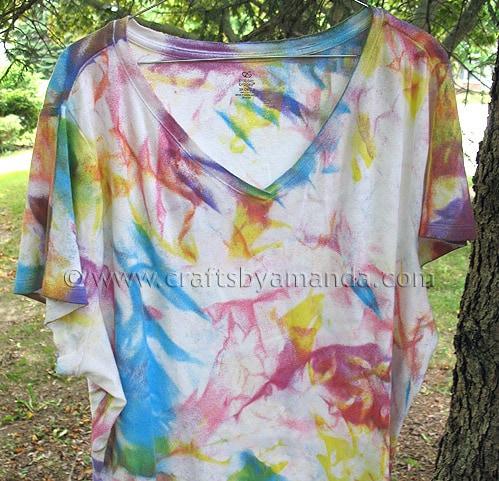 tie dye shirt on a hanger