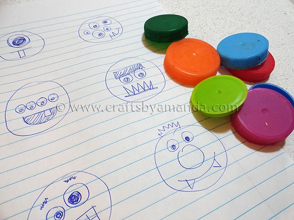 Plastic lid monsters crafts by amanda for Plastic craft boxes with lids