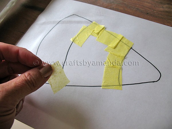 adding tissue paper to candy corn stencil