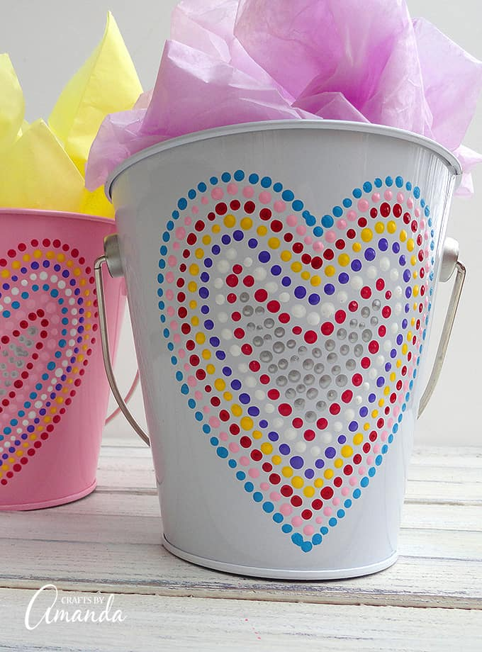 Valentine's Day is coming soon, so you're going to need something fun to give out goodies in! These Valentine treat buckets adorned in polka dotted hearts make for a great gift filled with chocolate or other candies.
