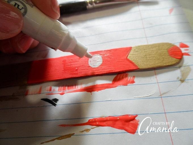 painting iron man on craft stick