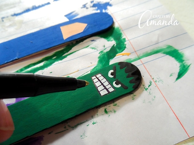 drawing hulk face on craft stick
