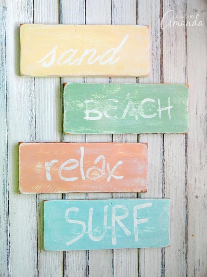 Weathered beach signs in pastel coastal colors