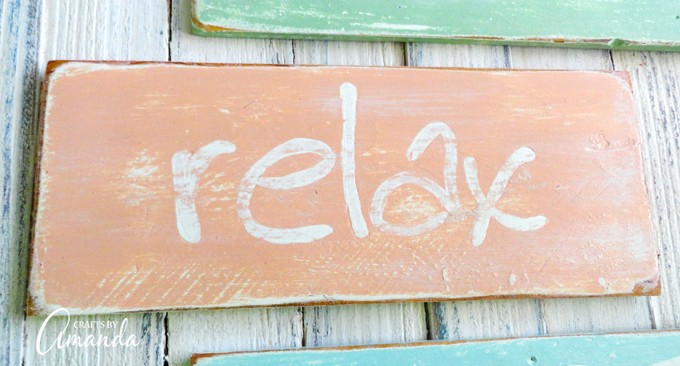 Beige RELAX beach sign