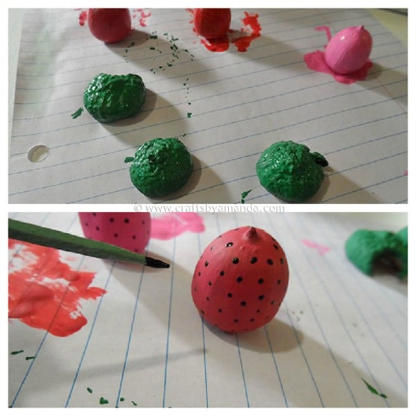 painting the strawberry acorn magnets