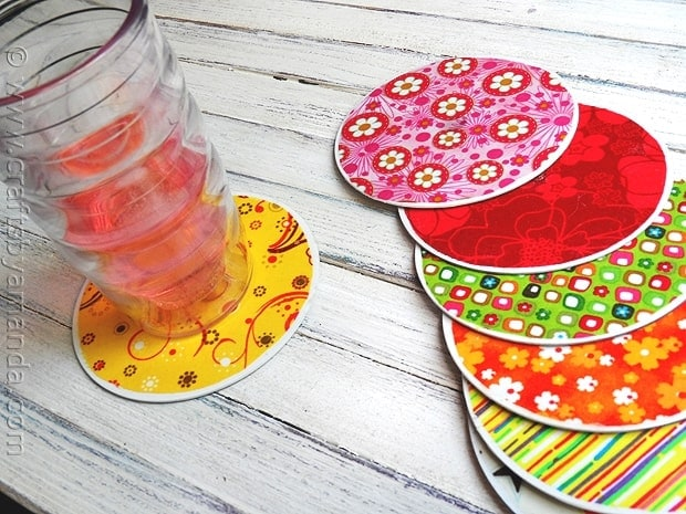 There are tons of fun recycled projects that you can do to reuse, repurpose and bring life back to things you no longer have interest in using, just like these recycled CD coasters!