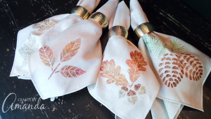 Use glitter paint to decorate plain fabric napkins. These glittery Thanksgiving napkins won't shed glitter and look great on your table!