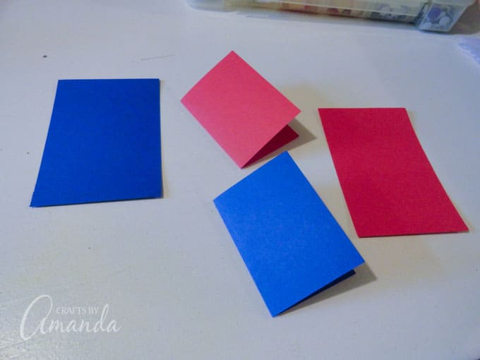 folding construction paper to make a card