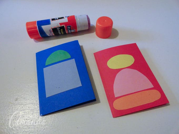Gluing on cut out construction paper