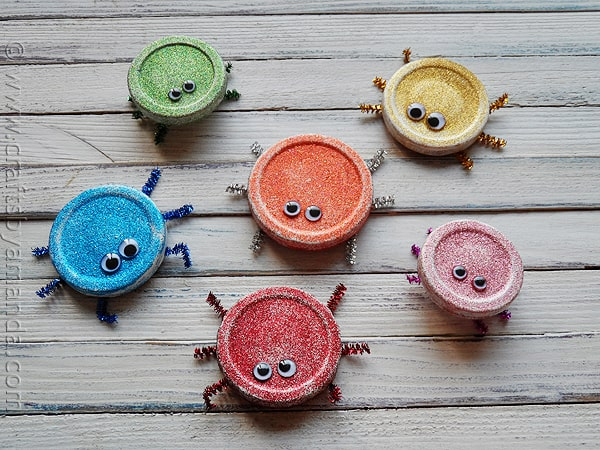 Recycled lid craft glitter bugs from jar lids for Glitter crafts for kids