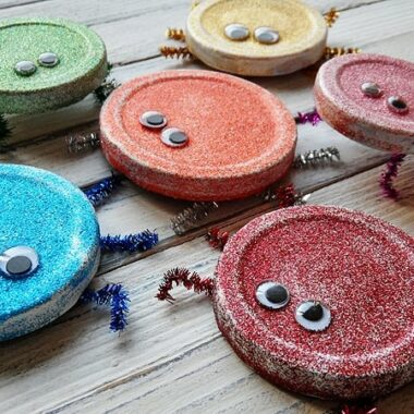Cute Glitter Bugs made from recycled jar lids! Great for Earth Day! From CraftsbyAmanda.com