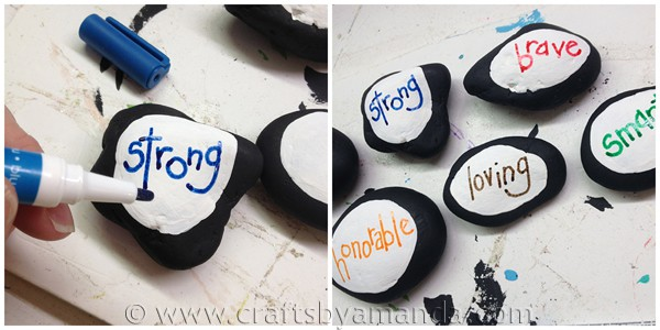 Use paint pens to write words on the painted stones