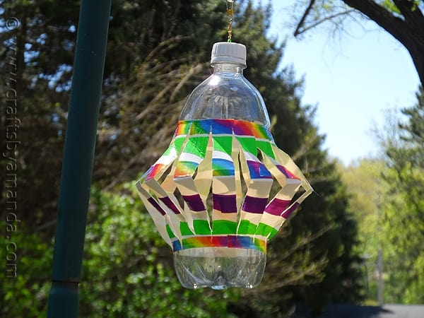 plastic bottle made into a wind spinner with colorful duct tape