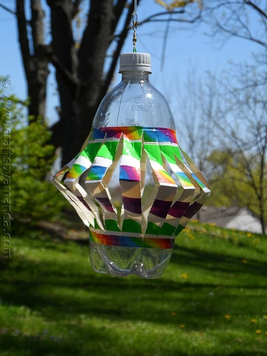 plastic bottle wind spinner with colorful duct tape outside