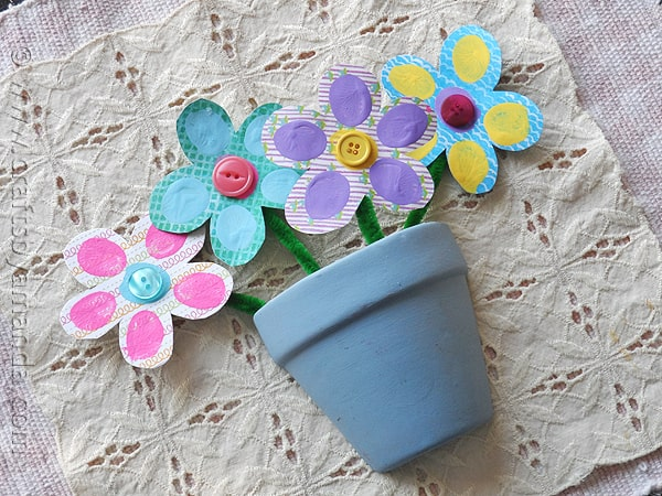 Colorful scrapbook paper in the shape of flowers with fingerprints