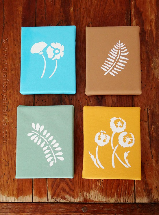 Stenciled Botanicals on Canvas in blue, brown, green, and orange