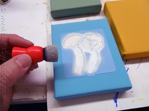 blotting the paint on the stencil