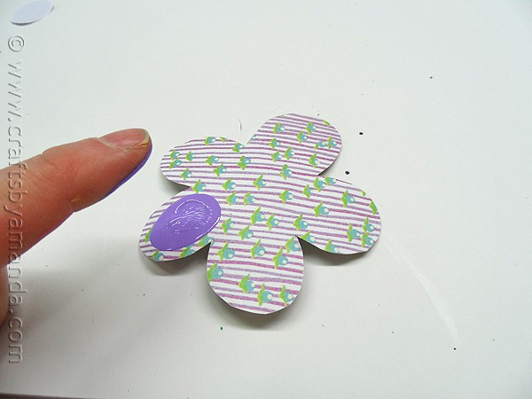 press your fingerprint with paint onto flower shape