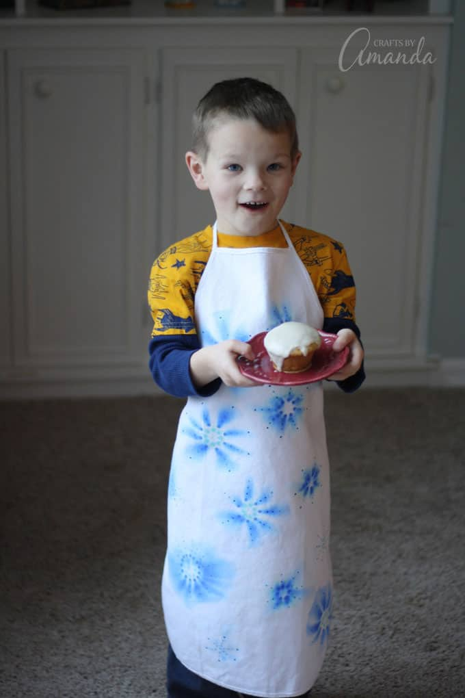 CHILD WEARING APRON