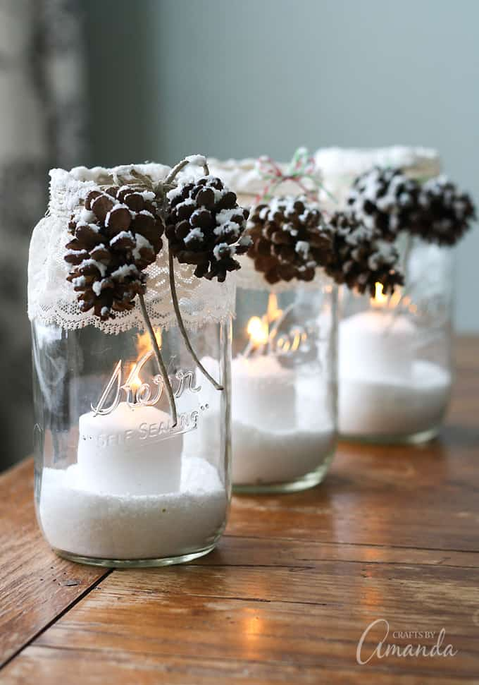 snowy jars with candles