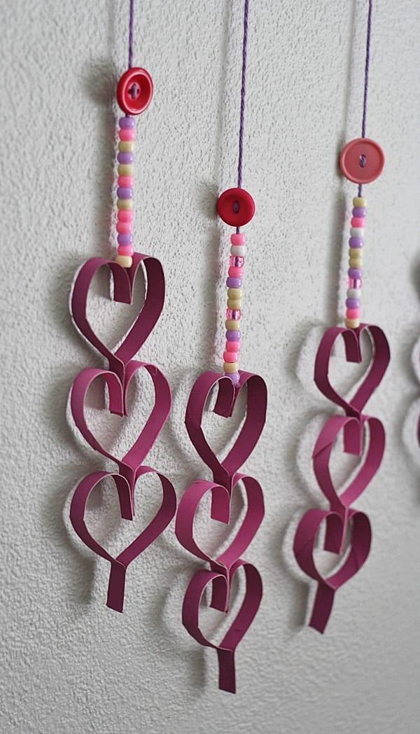 Cardboard Tube Dangling Hearts @amandaformaro Crafts by Amanda