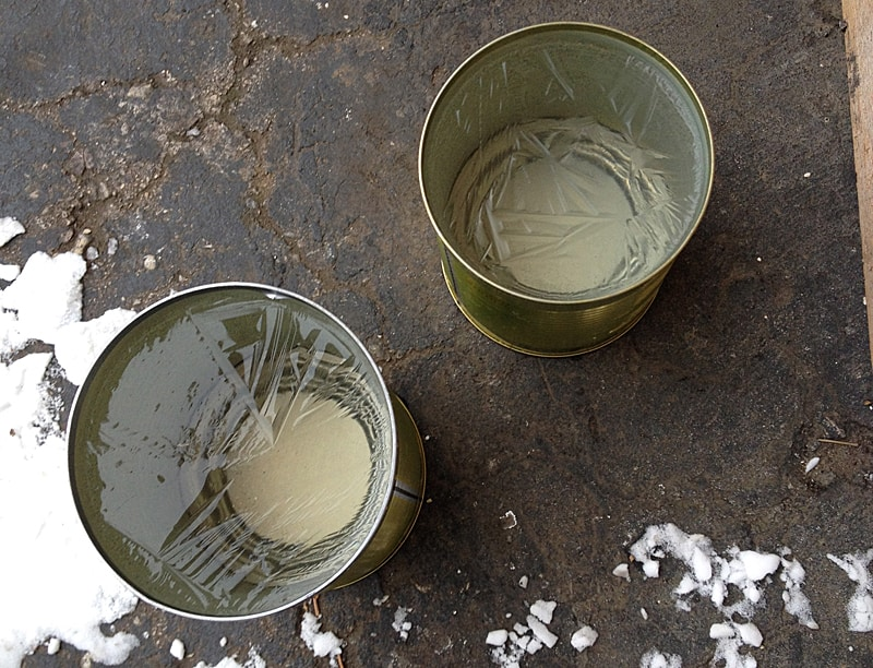 cans with partially frozen water