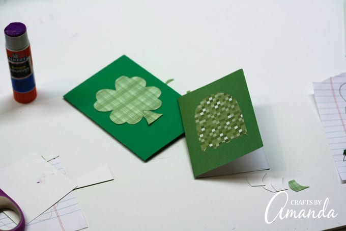Use a glue stick to attach them to the front of the cards.