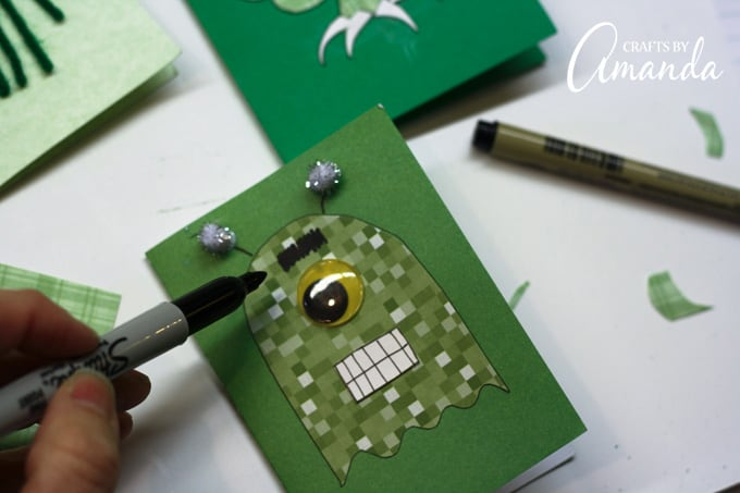 Add features and embellishments using googly eyes, markers, pom poms, and scrap paper.