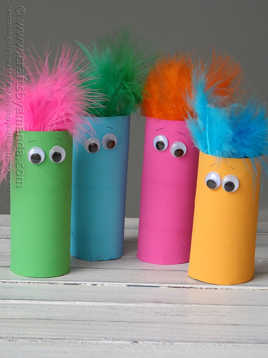 What a simple craft for the kids! These cardboard tube featherheads are too cute! #kidscrafts @amandaformaro