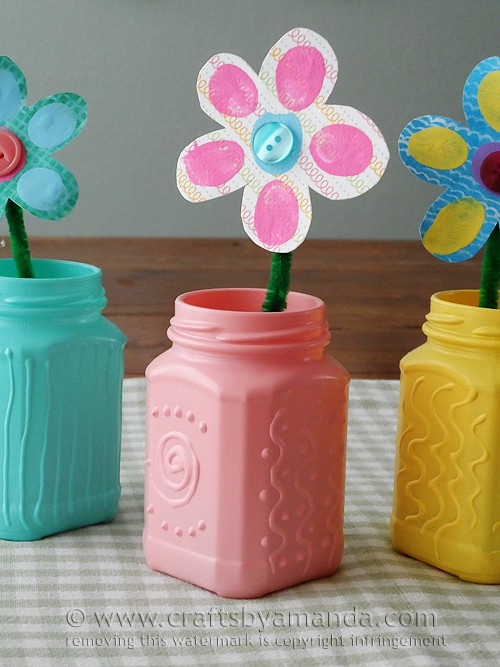 I can't wait to make these! These recycled jars will look great in the center of my table for Easter. So. Doing. it.
