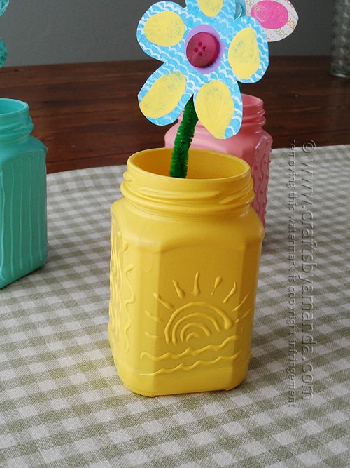 I love all these recycled spring jars, but the sun design is my favorite. oh the possibilities!