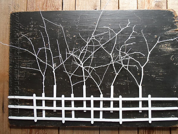 This Stick Tree Silhouette is not attached to this black plywood board, but that would be a cool option!