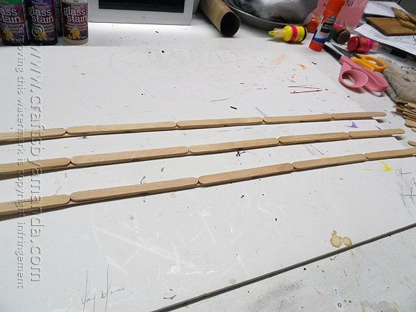 Use additional craft sticks to hold the fence together