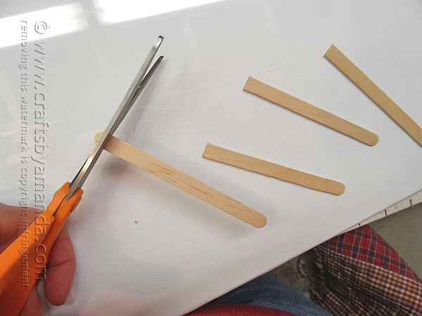 Cut the rounded ends off of the craft sticks