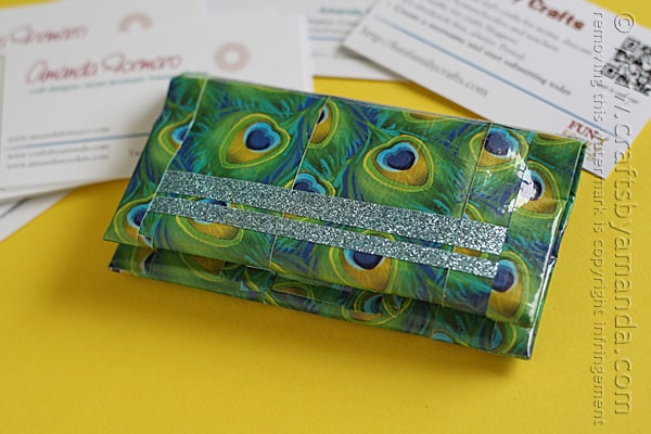 I really, really like this business card holder! It's peacock duck tape and glitter duck tape!