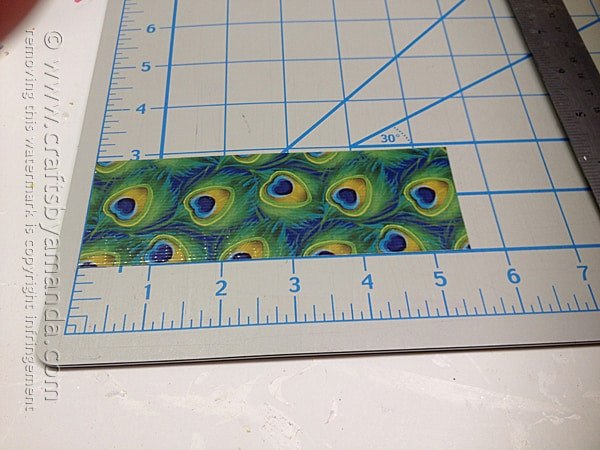 measure and cut a 5 1/2 inch piece of peacock duck tape