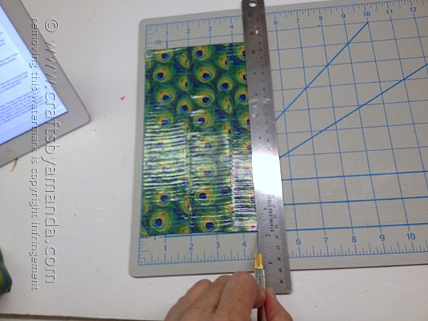 next, measure and trim the duck tape sheet