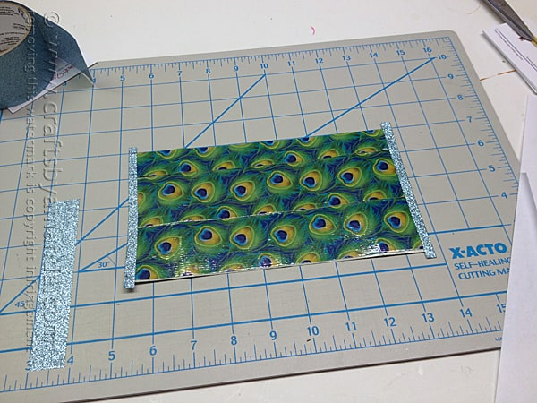 cover edges of duck tape sheet with glitter duck tape
