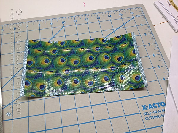 Fold the duck tape sheet in half and crease it