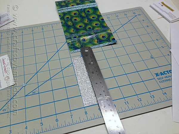 measure and cut silver glitter tape for the center reinforcement of the business card holder