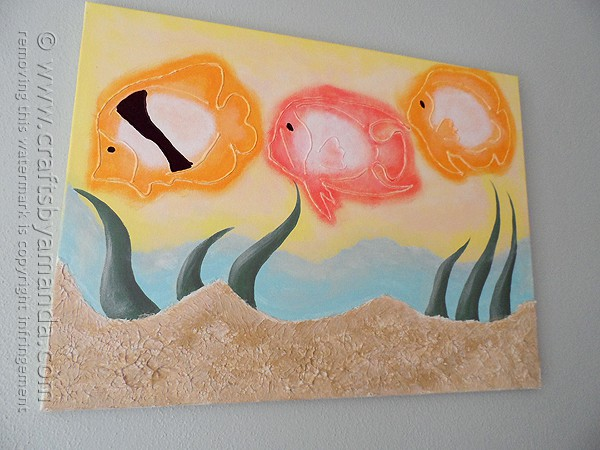 Beautiful canvas painting of tropical fish with a three dimensional affect - by @amandaformaro