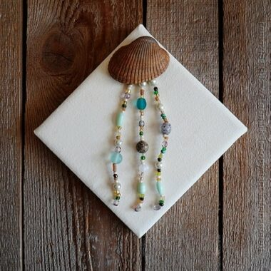 Pretty jellyfish made with a seashell and gorgeous beads, I love this!