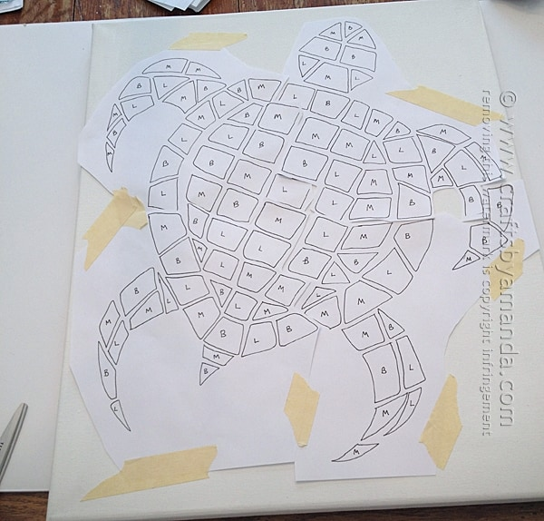 Next I taped the mosaic turtle pattern onto the canvas